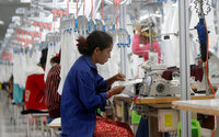 Cambodia, faced with losing European trade status, raises textile workers' wages