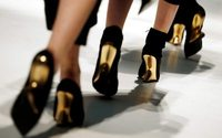 Italy's Ferragamo shares tumble after family trims stake