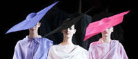Diaphanous dresses, angular tailoring close Milan fashion week