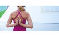 Yogawear retailer Lululemon cuts forecast&#x3B; shares slump