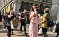 UK shoppers shrug off inflation pressure as sun comes out