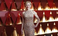 Old Hollywood, politics and winter white light up Oscars red carpet