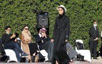 Chic abayas on the catwalk in rare Saudi fashion show