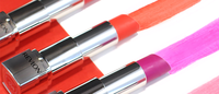 Revlon posts sales increases, turns $13 million adjusted profit