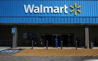 Walmart CEO points to new company culture, cuts profit forecast