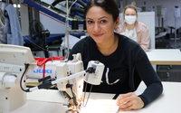 Wilvorst stellt Produktion von Hochzeitsanzügen auf Atemschutzmasken um