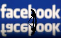 Facebook beats revenue, profit estimates, shares rise