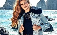 Guess returns to black in Q3, revenues miss