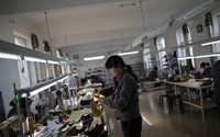 North Korea factories humming with Made in China clothes, traders say