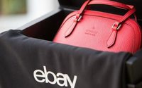 Ebay attracts more customers, lifts yearly forecast