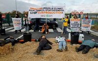 Environmentalists blockade Amazon warehouse in France in 'Block Friday' protest