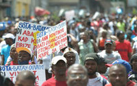 Haiti textile workers protest minimum wage as managers threaten exit
