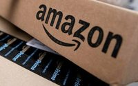 Amazon plows ahead with high sales and spending, profit plunges