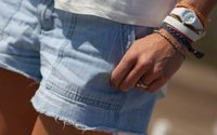 Sunny weather spurs UK shoppers to spend on shorts and tees