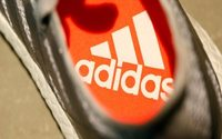 Adidas buyback, profit forecast set to boost shares