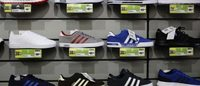 Sports Direct shares drop as founder says profits to fall