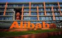 Alibaba beats quarterly revenue estimates, shares rise