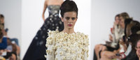 Oscar de la Renta scores with sophisticated, elegant designs