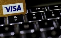 Visa tops profit estimates on higher consumer spending