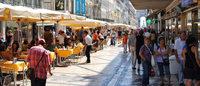 Lojas tradicionais de Lisboa querem contenção no número de mercadinhos de rua