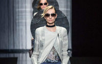 Armani revels in new freedom with catwalk charm offensive