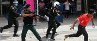 Cambodian troops in riot gear break up factory strike