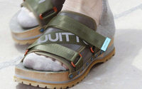 Socks and sandals bring whiff of scandal to Paris catwalk