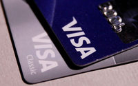 Visa profit jumps, lower cross-border volume weighs on shares