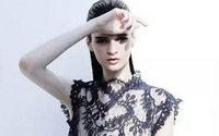 Shanghai designer impresses NY with banker chic