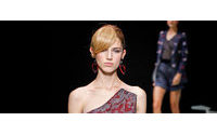 """King Giorgio"" Armani wraps Milan Fashion Week with play on red"