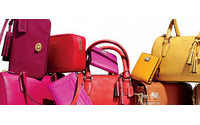 Coach North American comparable sales tumble 21 percent