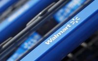 Walmart tests delivery of online packages by store workers